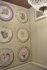 The ladies - wallpapered with cats on plates and there was a chandelier.