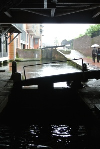 Going under the buildings.  Note the miserable weather.