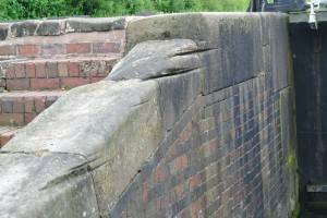 The grooves in the wall here were caused by the ropes worn by the horses pulling the boats through, before motors!