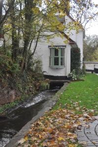 Water running under a lock side cottage