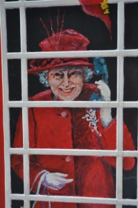 Her Maj - on the side of a phone box.