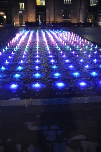 Dancing fountains, no music, lots of colour tho.   Behind Kings Cross Station.