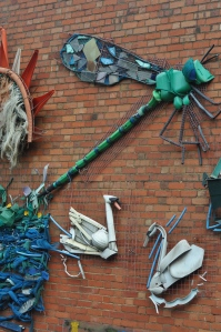 Part of a mural made with rubbish out of the canal.